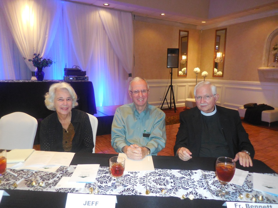 Former Secretary Patti Ann Walsh (sitting in for Secretary Peggy Walsh), Treasurer Jeff Day and Father Ernie Bennett of St. James Episcopal Church,who gave the invocation, at the head table.